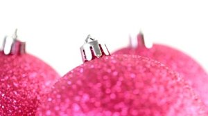 stock-footage-close-up-of-three-christmas-pink-christmas-tree-balls-rotate-isolated-on-white